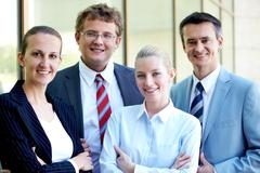 portrait of confident business leaders looking at camera with smiles - stock photo