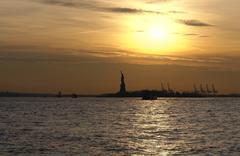 Statue of liberty and sundown Stock Photos