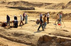 archaeological digging near statue of sphinx in egypt - stock photo
