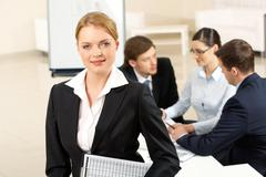 portrait of with smart employer looking at camera in working environment - stock photo