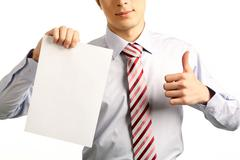 Image of human hand keeping thumb up while the other hand holding blank paper Stock Photos