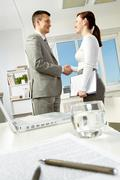 Photo of business partners handshaking after making agreement in office Stock Photos