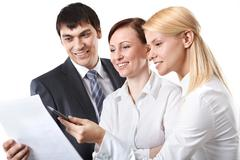 Three business people discussing some documents Stock Photos