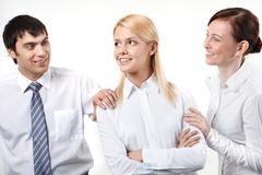 two business people patting his colleagues on shoulder - stock photo
