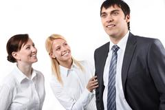 two business woman looking at their manager - stock photo