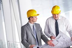 Two architects discussing new project at meeting Stock Photos