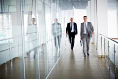 Stock Photo of business people walking in the office corridor