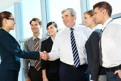 Photo of successful associates handshaking after striking deal with partners nea Stock Photos