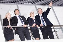 group of businesspeople with their senior boss - stock photo