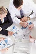 above view of businesspeople discussing graphs - stock photo