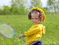 little girl playing badminton - stock photo