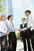 Photo of business partners handshaking at meeting in natural environment Stock Photos