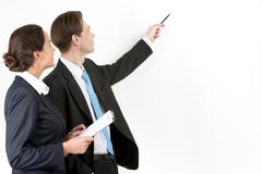 a businessman showing a plan to his colleague - stock photo