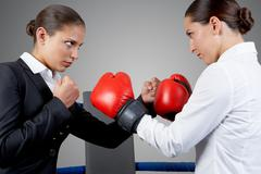 photo of aggressive business women fighting with each other - stock photo