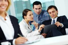 Portrait of several employees discussing plan in office Stock Photos