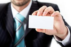 Close-up of businessman showing blank visiting card in his hand Stock Photos