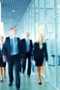 enthusiastic business team following the corridor - stock photo
