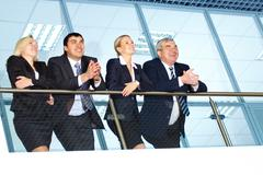 Business people looking away from camera and smiling Stock Photos