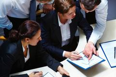 Above view of several business partners discussing business plan Stock Photos