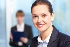 close-up of young smiling businesswoman's face - stock photo