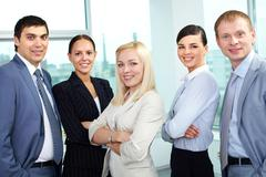 portrait of five businesspeople looking at camera and smiling - stock photo