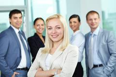 young colleague against other businesspeople - stock photo