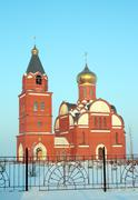 red brick churh in suburb of ufa, russia - stock photo