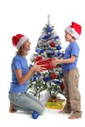 Mum gives a gift to the son for christmas Stock Photos