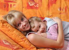 Cheerful mum with a daughter 3 Stock Photos