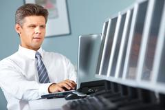 portrait of a manager working in office - stock photo