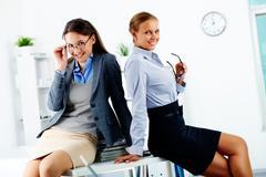 portrait of elegant businesswomen posing in office - stock photo