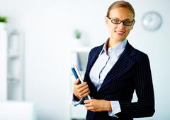 Portrait of confident businesswoman looking at camera in office Stock Photos