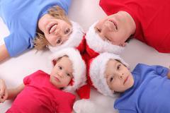 happy family in christmas hats 4 - stock photo