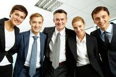 Portrait of successful business group looking at camera with smiles Stock Photos