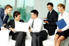 five business people communicating in office - stock photo