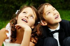 Portrait of cute boy groom and girl bride Stock Photos