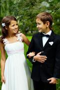 portrait of happy children bride and groom on wedding - stock photo