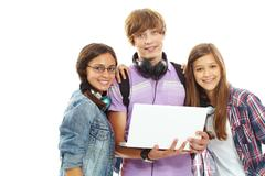 Three teenagers with laptop looking at camera Stock Photos