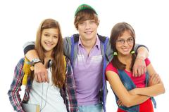 Three teenagers in casual clothes posing in front of camera Stock Photos