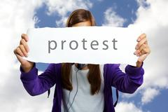 Image of teenage girl in casual clothes holding blank sheet of paper image of te Stock Photos