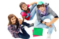 three teenagers in casual clothes looking at camera - stock photo
