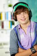 Portrait of smart lad in headphones looking at camera Stock Photos