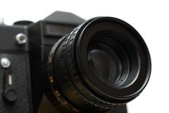 Black slr camera with lens close-up Stock Photos