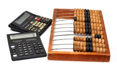 old abacus and two calculators - stock photo