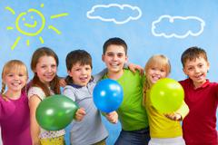 team of children embracing each other during summer vacation - stock photo