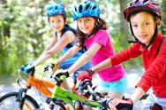 Stock Photo of three little children riding their bikes