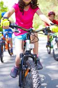 Close-up of children's bike ridden by a girl Stock Photos
