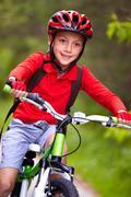 Portrait of a boy riding a bike Stock Photos