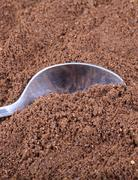 milled coffee  and teaspoon - stock photo