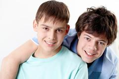 portrait of two happy teenage boys - stock photo